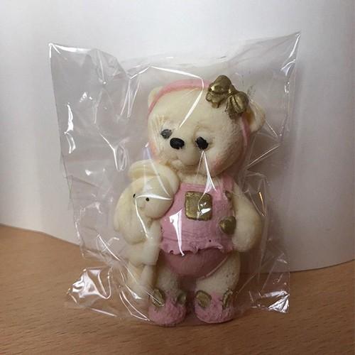 Мишка с игрушкой (100 гр.)